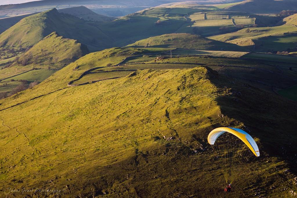 High Wheeldon Sunset - A Paraglider passes across the ridge